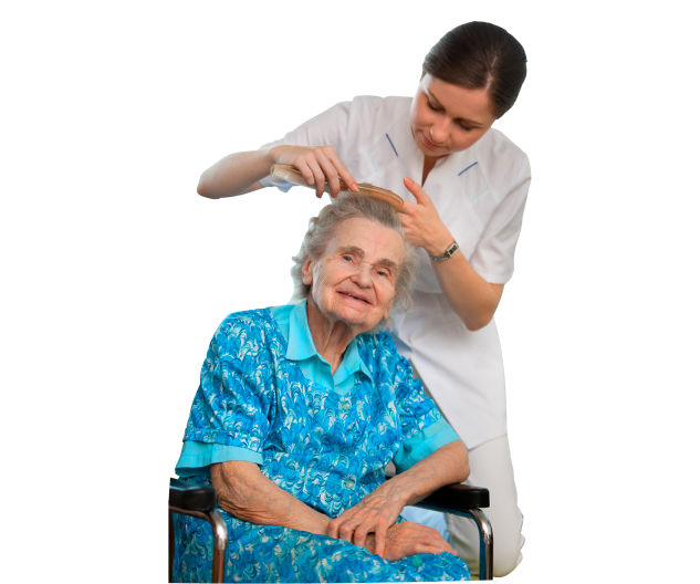 caregiver combing the hair of an old woman